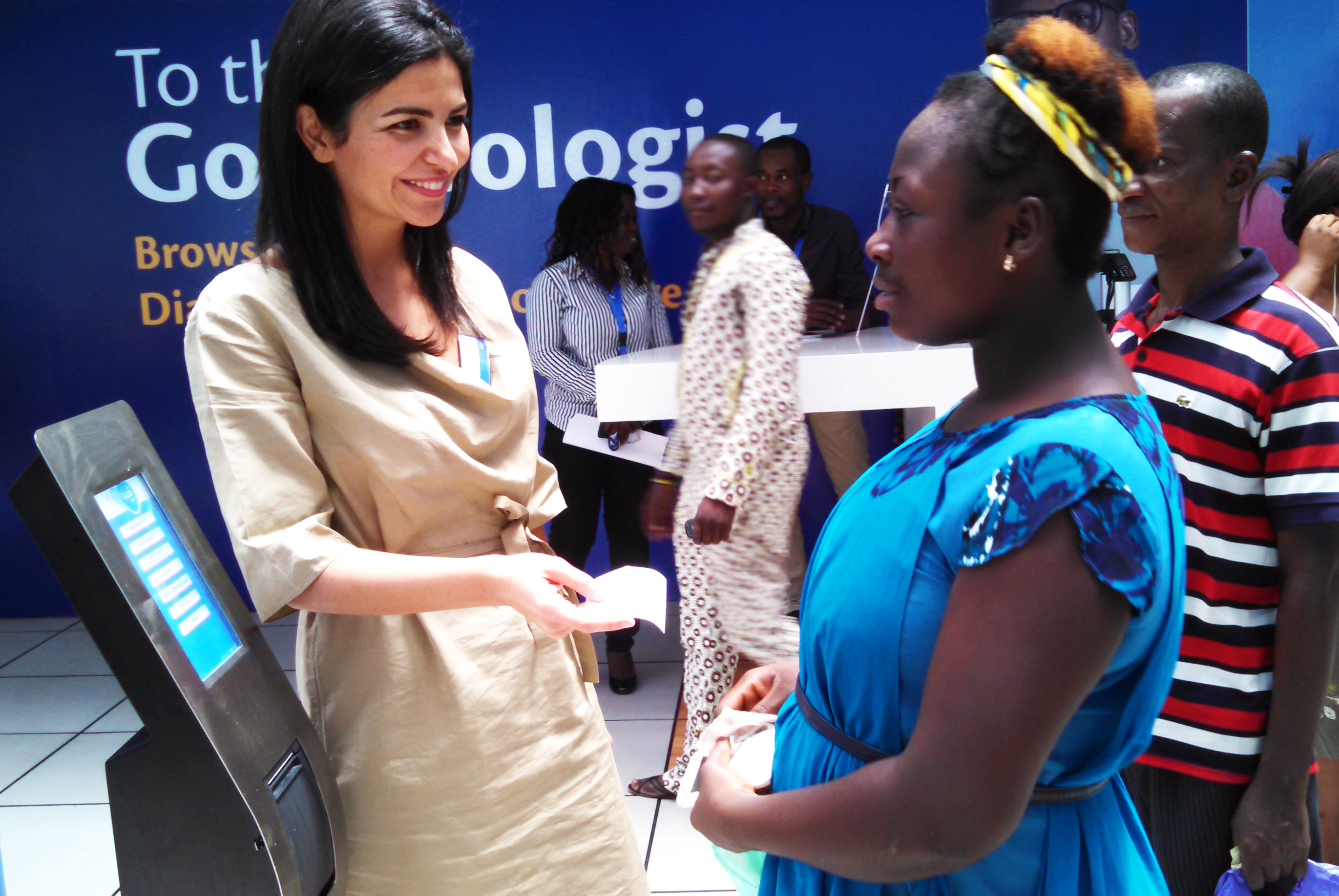 Tigo Ghana CEO Roshi Motman helping customers
