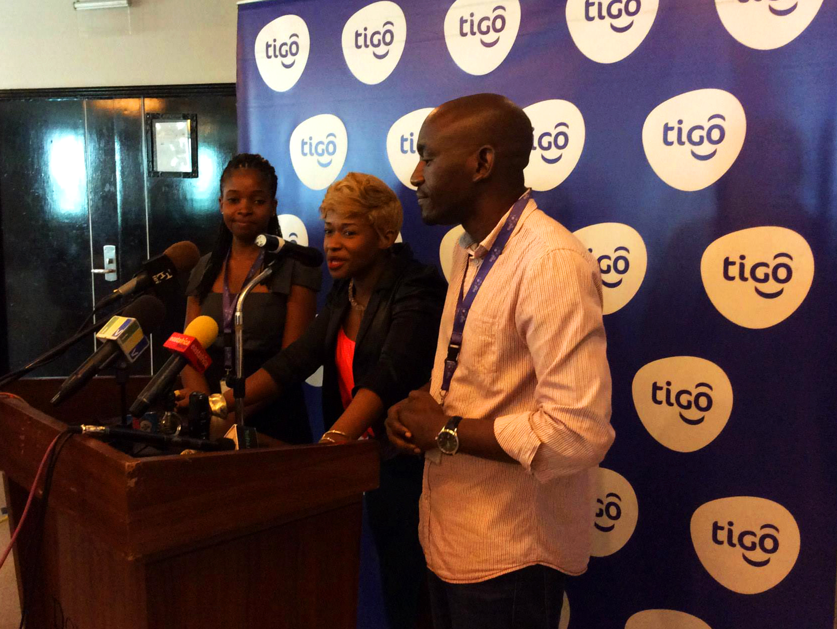 © Tigo Tanzania. Music artist Linah Sanga (centre) with Tigo representatives at the launch event in Dar es Salaam on 13 January 2015.