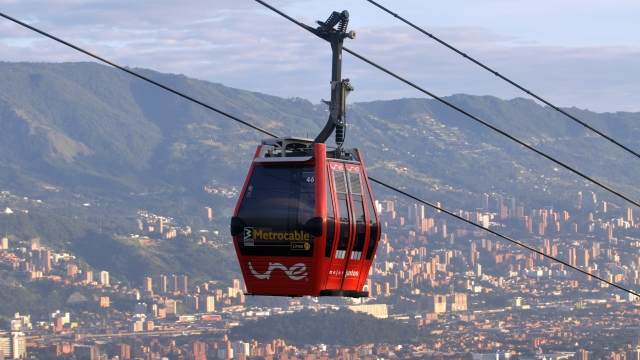 © UNE sponsored cablecars rise above the City of Medellin