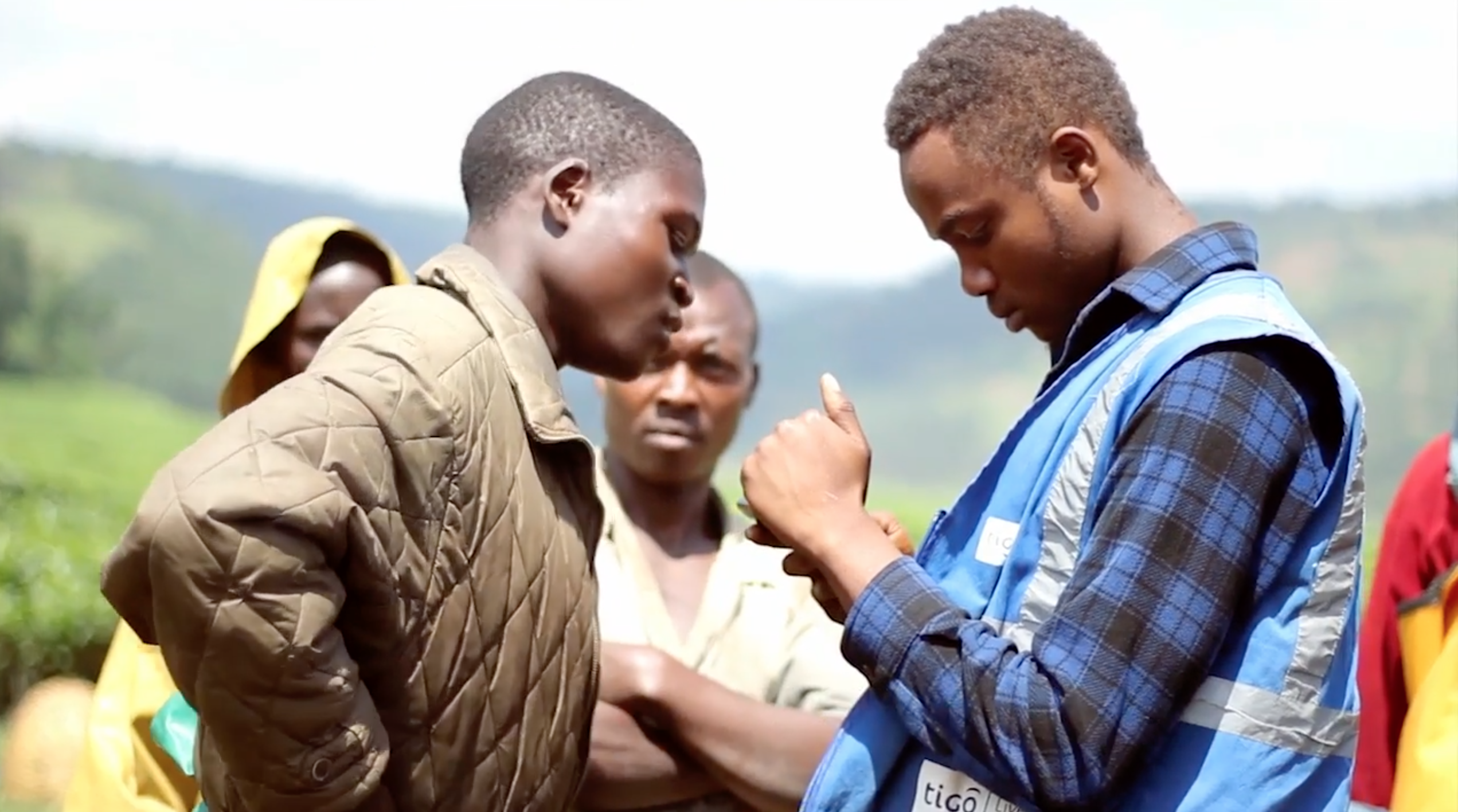 ©Tigo Cash agent introduces one of Rwanda's 10,000 tea farmers to mobile banking - July 2016.